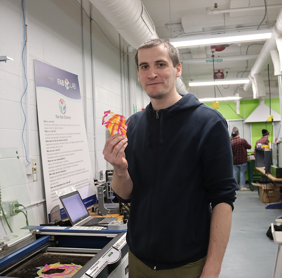Artem Korotkov, a doctoral student and research from the National University of Science and Technology MISIS in Moscow, uses Fab Lab equipment to make a state of Wisconsin ornament.