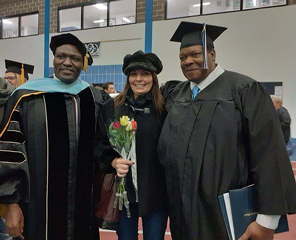 DeAngelo and his wife, Shelly, celebrate Golden's graduation with Associate Professor Brian Oenga.