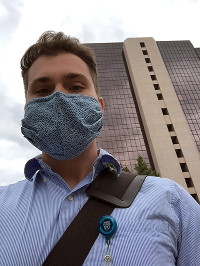 Jack Hemsath wears a protective mask outside Mayo Clinic in Rochester, Minn., where he works in the Infectious Diseases Lab.