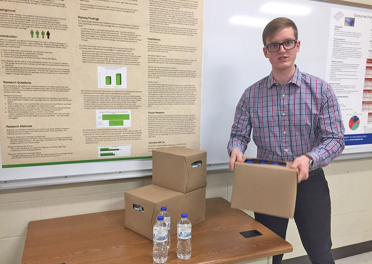 UW-Stout packaging student Ben Cram talks about a paperboard case for bottled water that appeals to upscale customers for its sustainability over plastic shrink wrap.