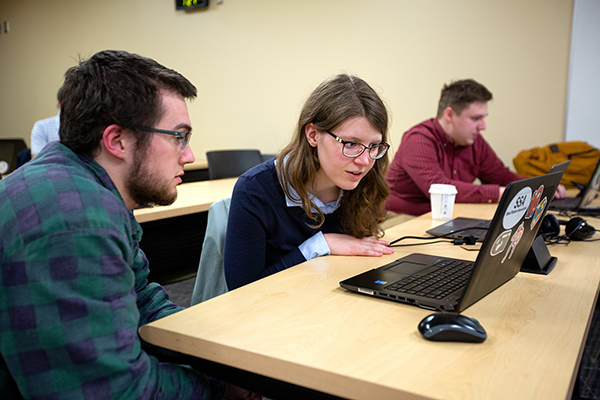 From left, Calvin Bunge, Larissa Ford and Ryan Vanden Boomen work on case studies in their Industrial Math class at UW-Stout.