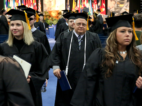 Dave Lytle receives his bachelor's degree in management in 2014, about 35 years after he first enrolled at UW-Stout.