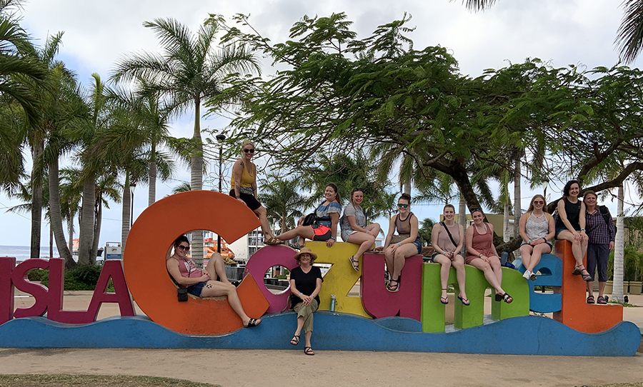 Nine UW-Stout students along with professors Terry Kohlmeier, third from left, and Ruth Nyland, right, went to Cozumel, Mexico, in January to volunteer in schools.