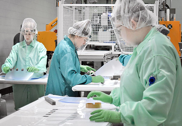 Workers at Prent in Janesville make plastic face shields to help those involved the fight against the coronavirus pandemic. / Prent photo