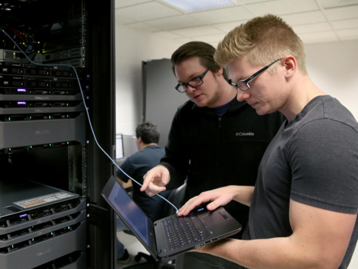 UW-Stout students Pierce Lannue, left, and Stephen Felton work in a computer networking and information technology lab in October in Fryklund Hall. UW-Stout has been named a national Center of Academic Excellence in Cyber Defense.