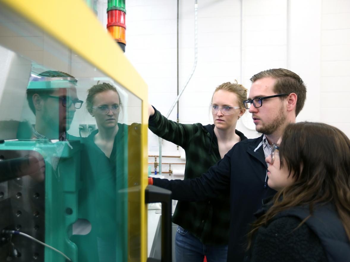 From left, students Natalie Deeg, Thomas Hirsch and Rebecca O'Brien work in the plastics engineering lab at UW-Stout.