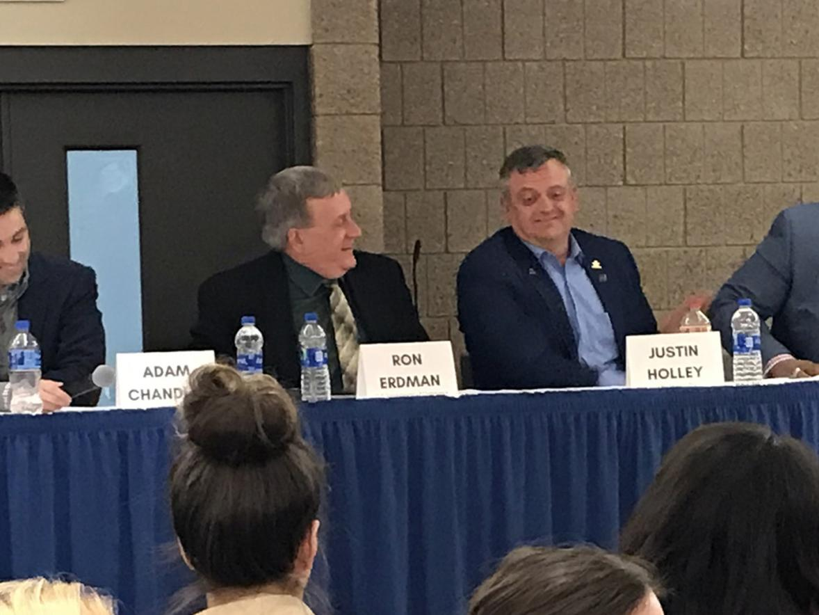 UW-Stout alumnus Michael Wilson, right, laughs during a panel discussion at the School of Hospitality Leadership 50th anniversary event.