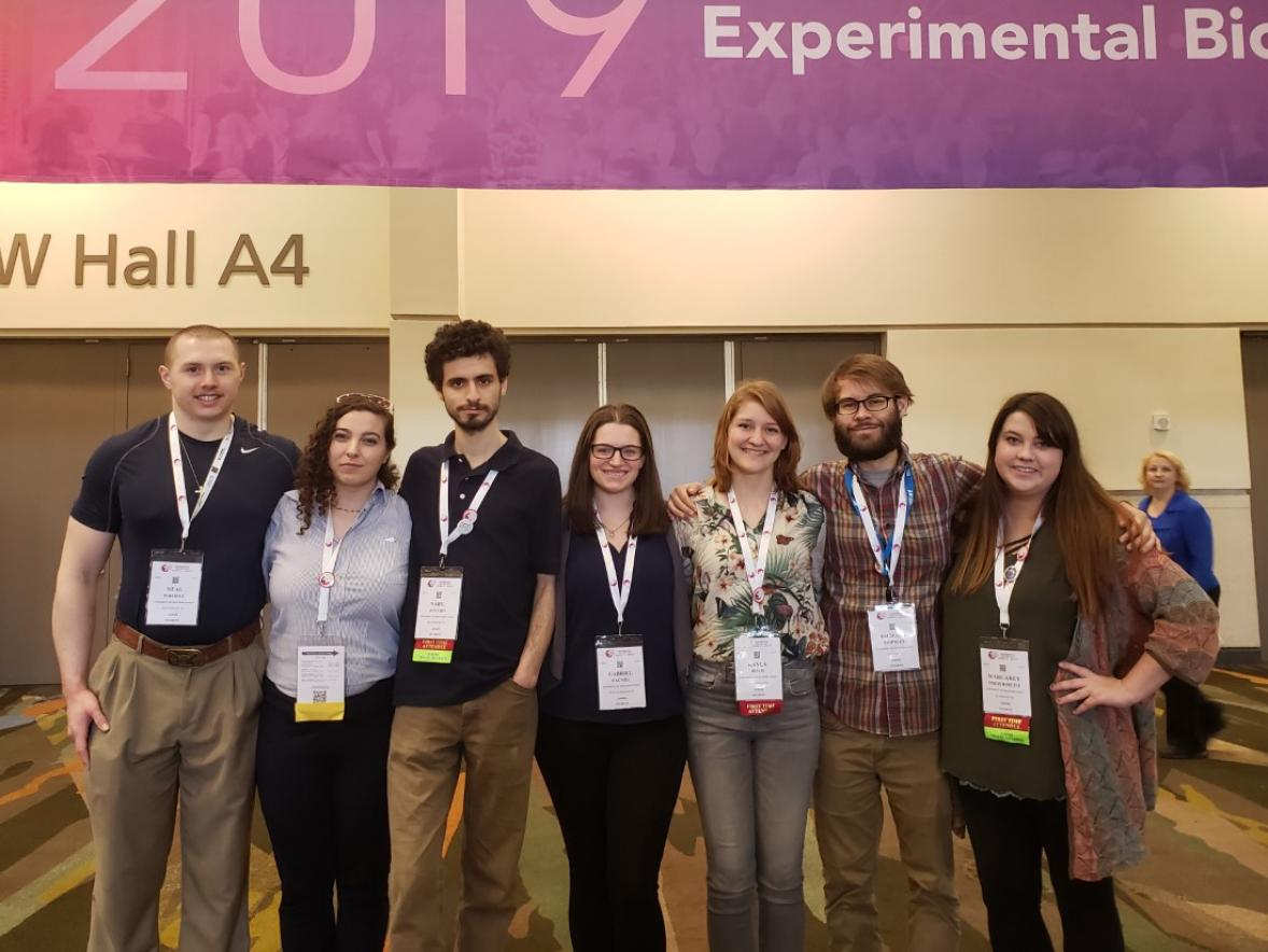 UW-Stout ASBMB members posing under the Experimental Biology 2019 banner.
