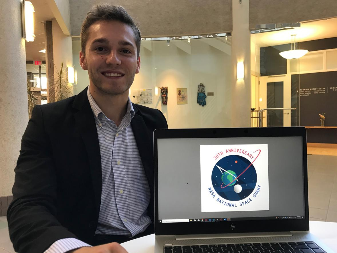 Kristofer Tremain won a national student contest with his NASA logo design.