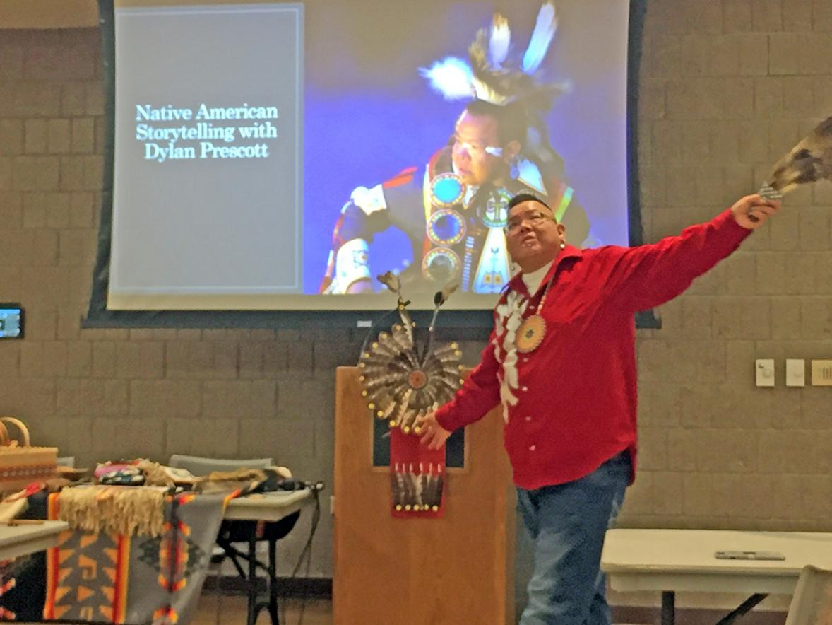 Dylan Prescott shared stories of the Ho-Chunk people at UW-Stout as part of Native American Heritage Month and used an eagle feather during one story.