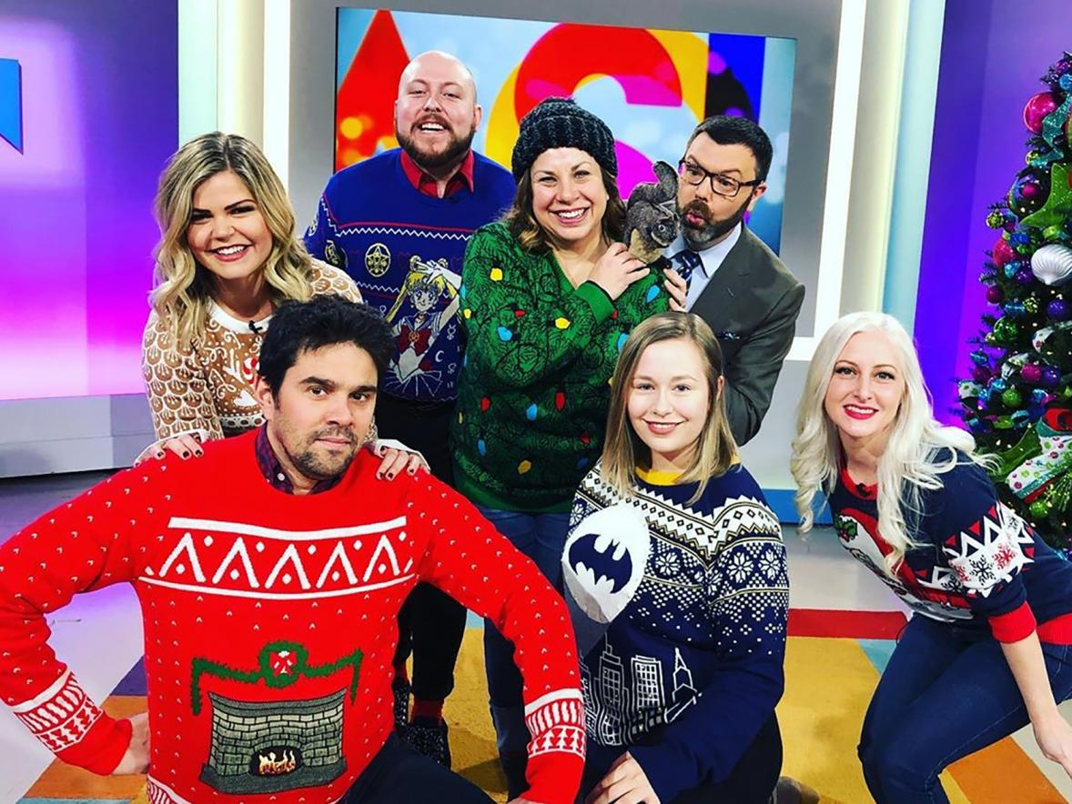 "UW-Stout apparel design alumnus Kurt Anderson, third from left, wears his ""Sailor Moon"" ugly Christmas sweater recently on the Twin  Cities ""Jason Show."" Anderson was a guest on the show promoting Fun.com's holiday sweaters."