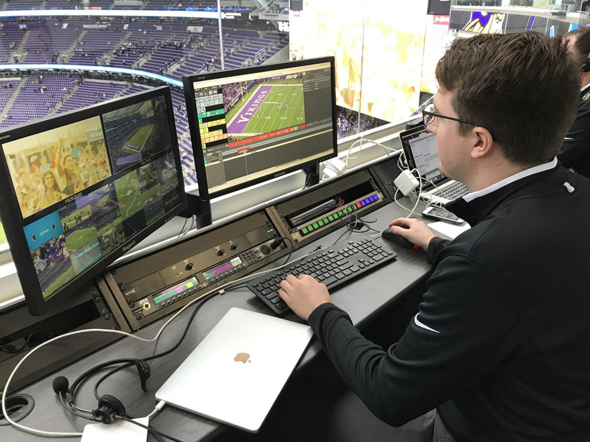 Connor Clark works in the U.S. Bank Stadium broadcast room. Clark collects footage and creates videos or adds graphics to footage for in-stadium fans at home Minnesota Vikings games.