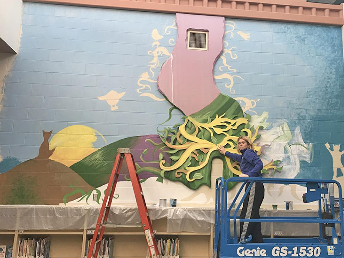 Tami Weiss works on the Oaklawn Elementary mural