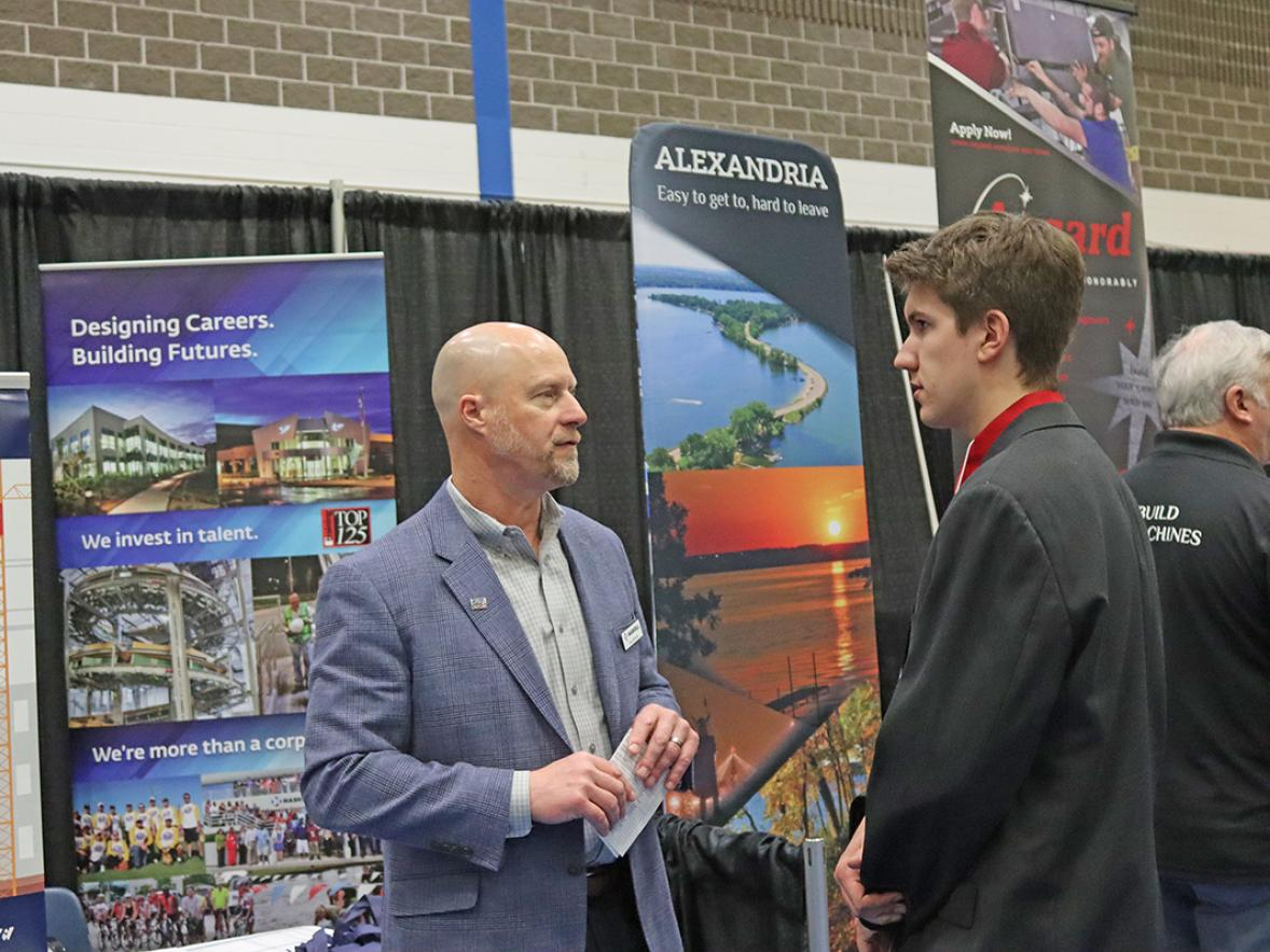 Dave Bartels, of Haskell Company, at left, talks with UW-Stout student Aaron Kurschner during the Spring Career Conference at UW-Stout Thursday, March 3.