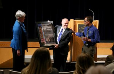 Jeff Ylinen (center) receives a plaque honoring him as an Executive in Residence from Deanna Schultz, associate professor in CTE, and Urs Haltinner, a CTE professor, Tuesday, February 13, 2018 in the Great Hall of the Memorial Student Center.