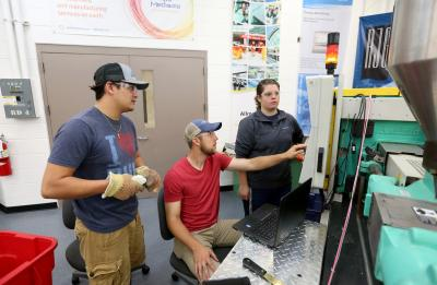 A lab section of Professor Adam Kramschuster's Injection Molding Theory, Design and Application class in the Plastics Engineering lab in Jarvis Hall Tech Wing.