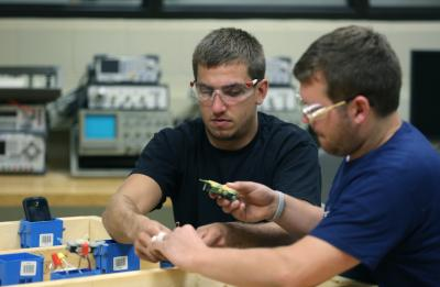 UW-Stout Engineering Technology students working on an electrical system.