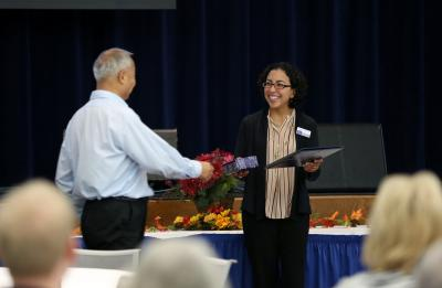 award recipient accepting award from interim provost Rodríguez at 2016 retirement reception