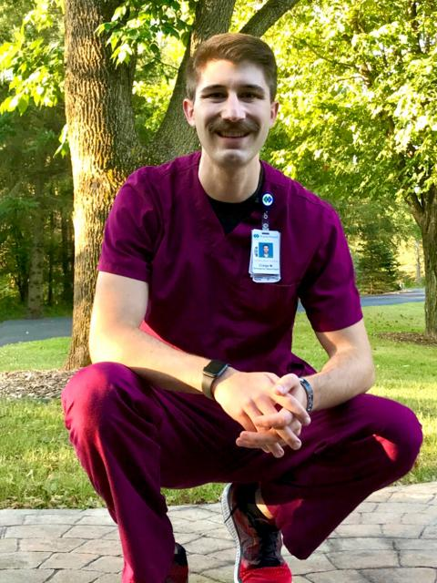 ABMB graduate Craige McConnell in his medical scrubs.